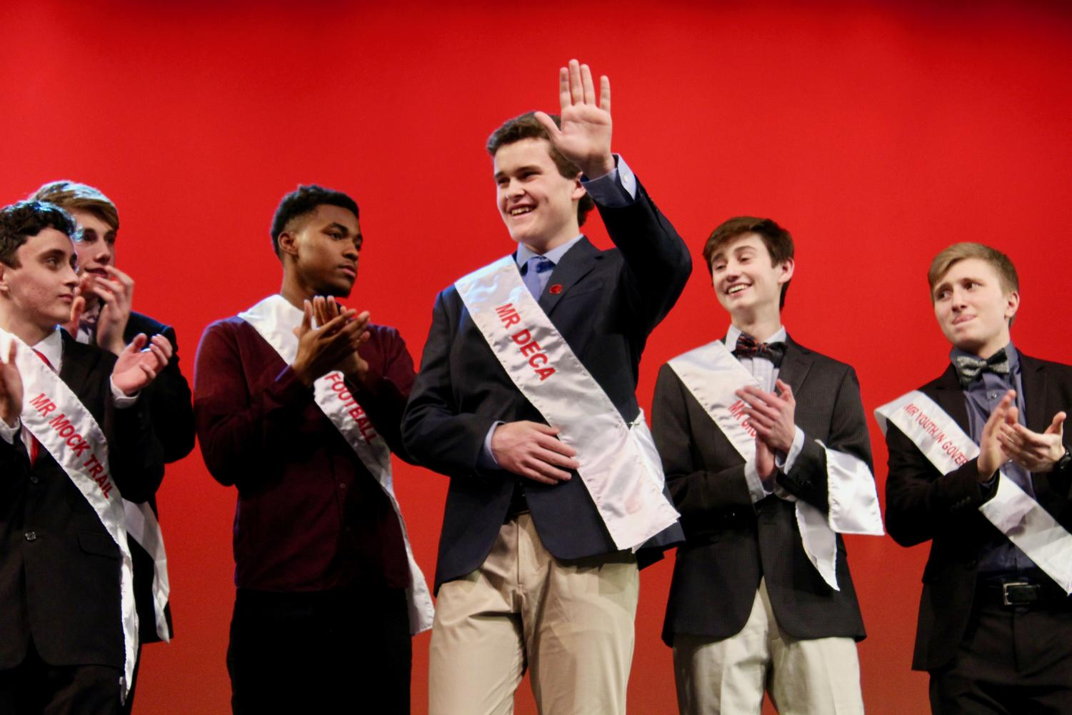 Jack+Dunn%2C+senior%2C+waves+to+the+crowd+after+being+announced+as+the+first+runner-up+for+Mr.+KHS.