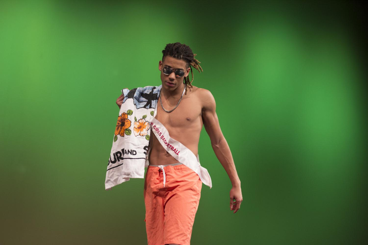Cornell+Young%2C+senior%2C+walks+onto+the+stage+during+the+swimwear+competition.+