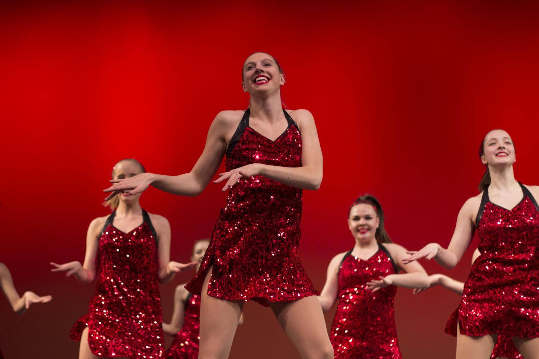Meagan++Biesiadecki%2C+senior%2C+dances+with+the+Pommies+between+segments.