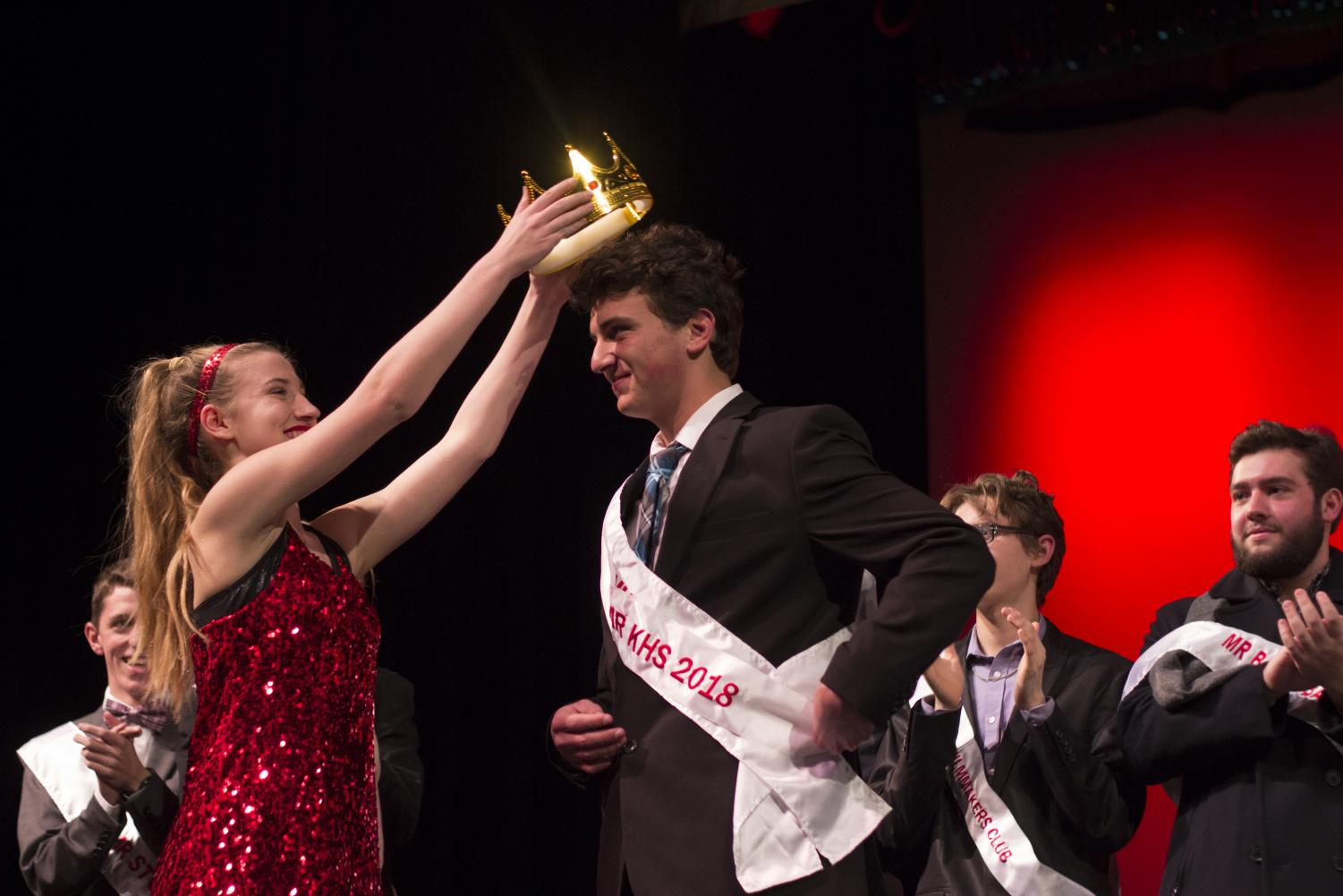 Zack+Demetri%2C+senior%2C+accepts+his+crown+after+winning+Mr.+KHS.+%22Honestly+I+wasn%E2%80%99t+expecting+%5Bto+win%5D%2C+but+I+was+definitely+happy+about+it+and+it+was+definitely+encouraging+that+my+efforts+to+be+more+involved+at+school+and+have+fun+and+be+myself+%5Bwere%5D+recognized%2C%22+Demetri+said.+