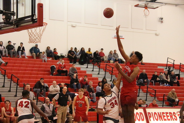 Leondre Clay, senior, shoots the ball in the paint.