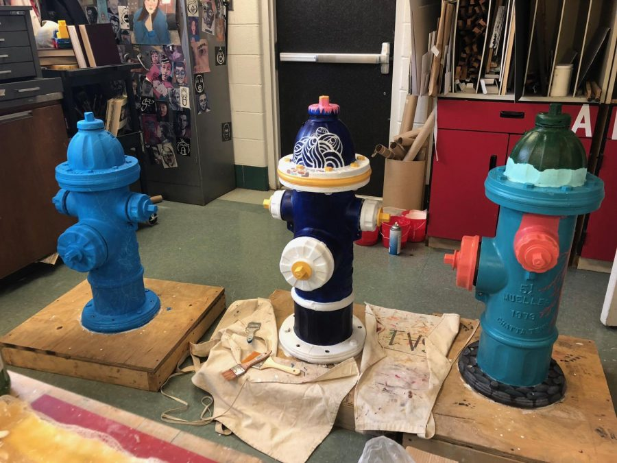 Three+of+the+hydrants+going+through+the+process+of+being+painted.