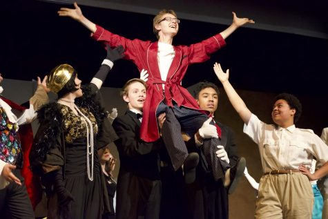 Jared Goudsmit, junior, is held up by his cast mates.