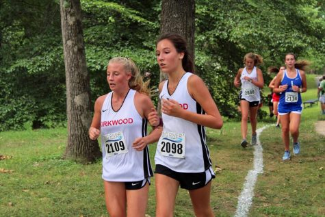 Mackenzie Scully and Kaylee Patterson, freshmen, approach the first mile marker.