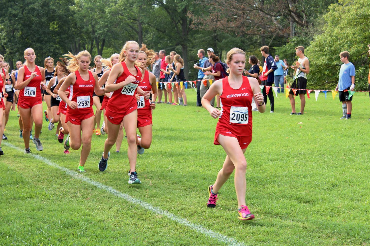 Meg+Murphy%2C+junior%2C+leads+a+pack+of+Kirkwood+runners+at+the+start+of+the+junior-senior+race.+%22%5BMy+favorite+part+of+the+Webster+meet+was%5D+probably+just+being+able+to+stick+with+my+other+teammates+and+push+myself+to+the+front+towards+the+end+of+the+race%2C%22+Meg+Murphy%2C+junior%2C+said.+%22%5BBeing+the+first+Kirkwood+girl+to+finish%5D+felt+really+good%2C+I+felt+really+energized+in+the+end+and+it+helped+me+push+to+my+finish.%22