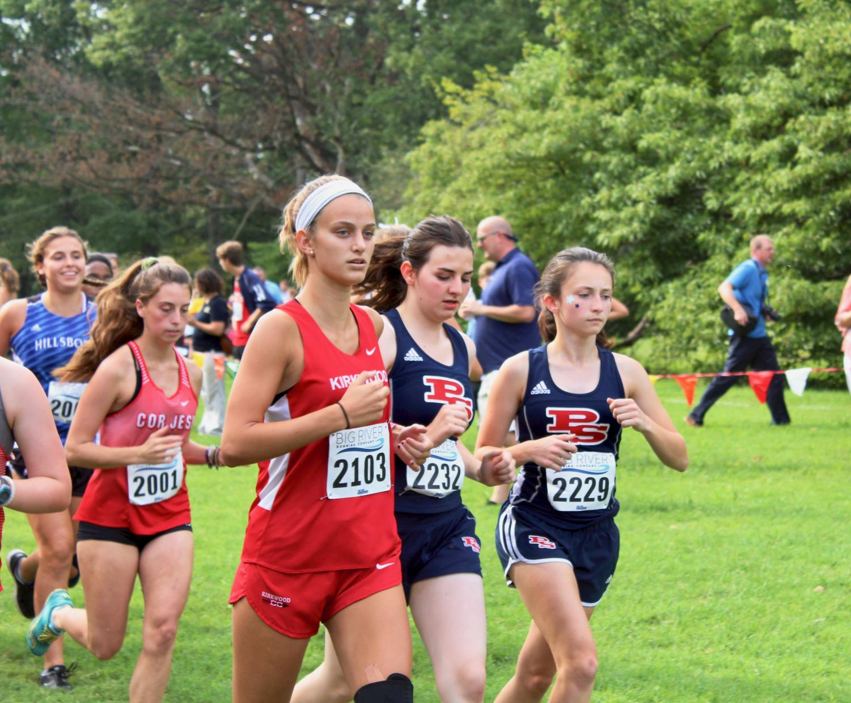 Emma+Pritchard%2C+senior%2C+sprints+in+the+beginning+of+her+first+5k.