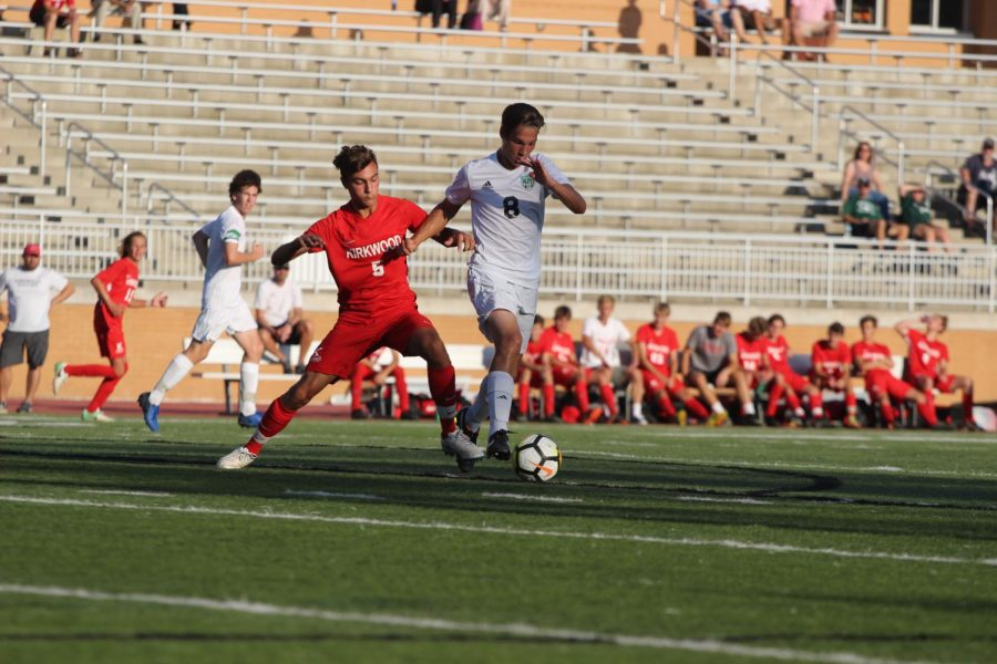 Jake Heinrichs, junior, attempts to block the opposing player and steal the ball back.