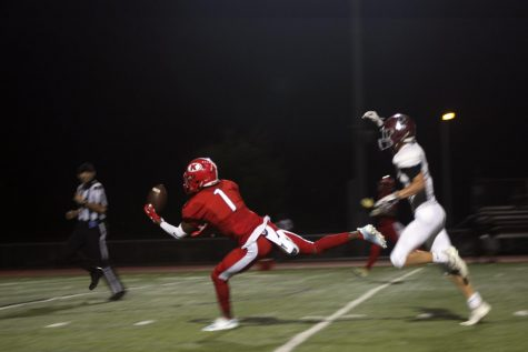 Maurice Massey, senior, reaches to catch the ball near the end zone.