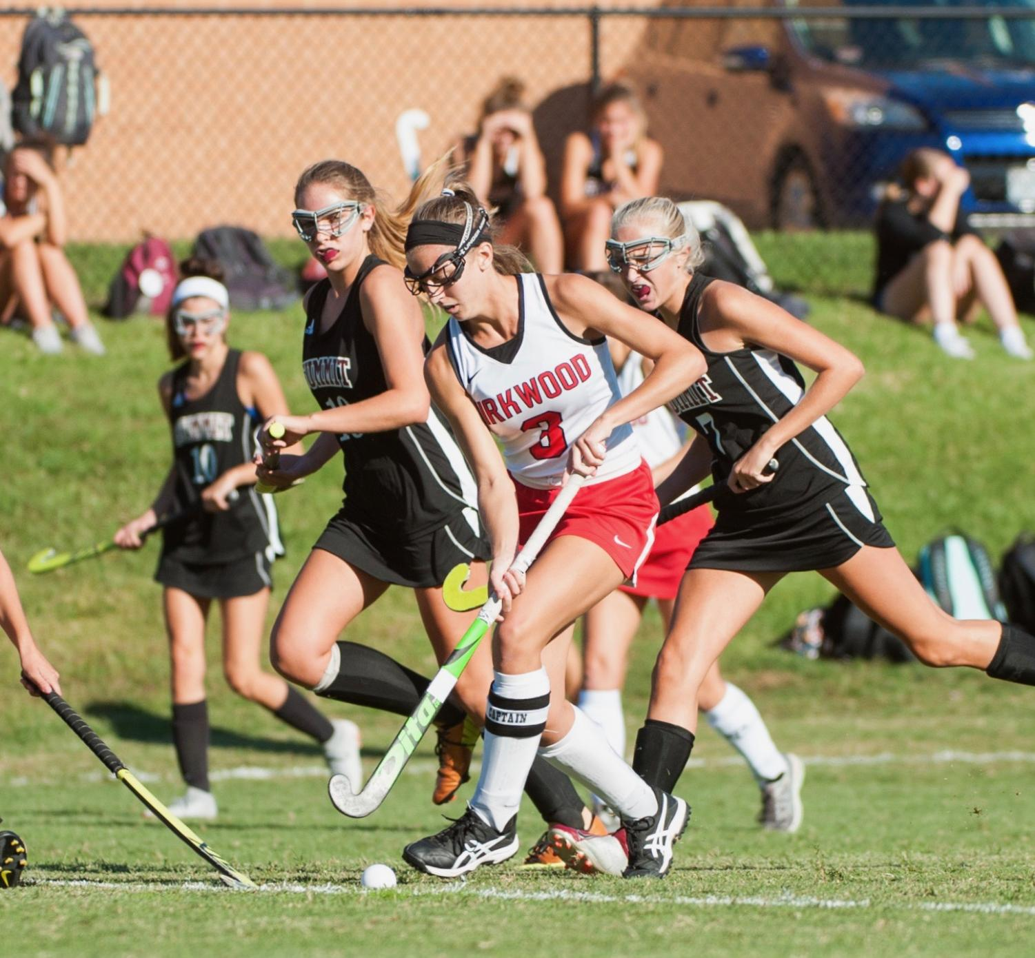 Cate Camenzind, senior, dribbles the ball down the field.