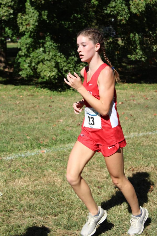 Amanda Ralston, freshman, maintains her pace throughout the race, finishing with a time of 21:29.