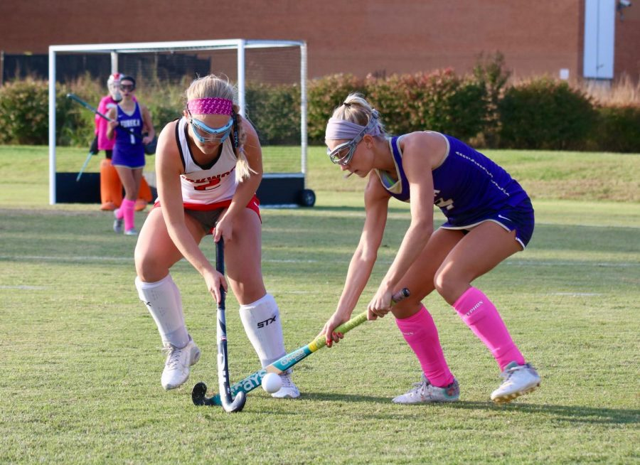 Morgyn Welsh, senior, jabs at the ball as a Eureka player attempts to dribble the ball.