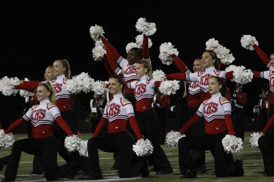 Kirkwood varsity pommies strike their final pose at the end of their halftime performance.