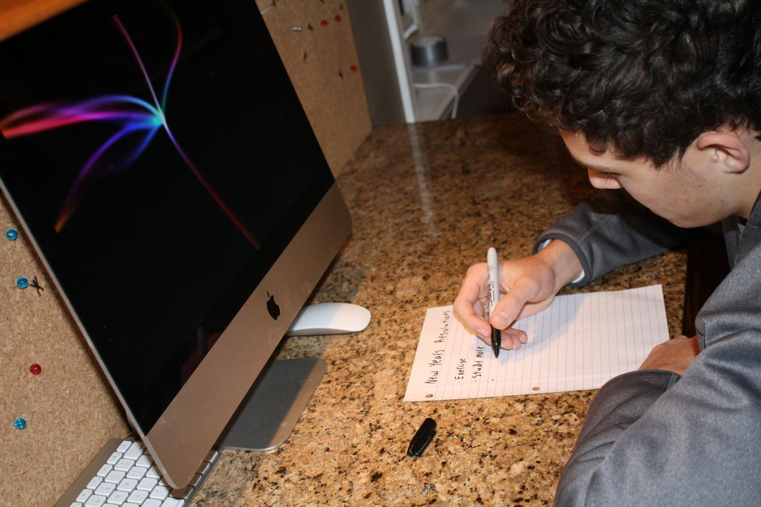 Will Rives, senior, writes out his New Year's resolutions.