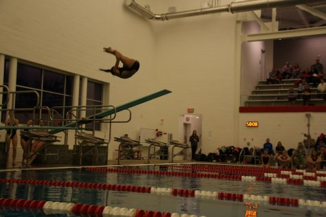 Olivia Inion, freshman, does a reverse flip off the diving board. She has been diving on and off since the age of 5.