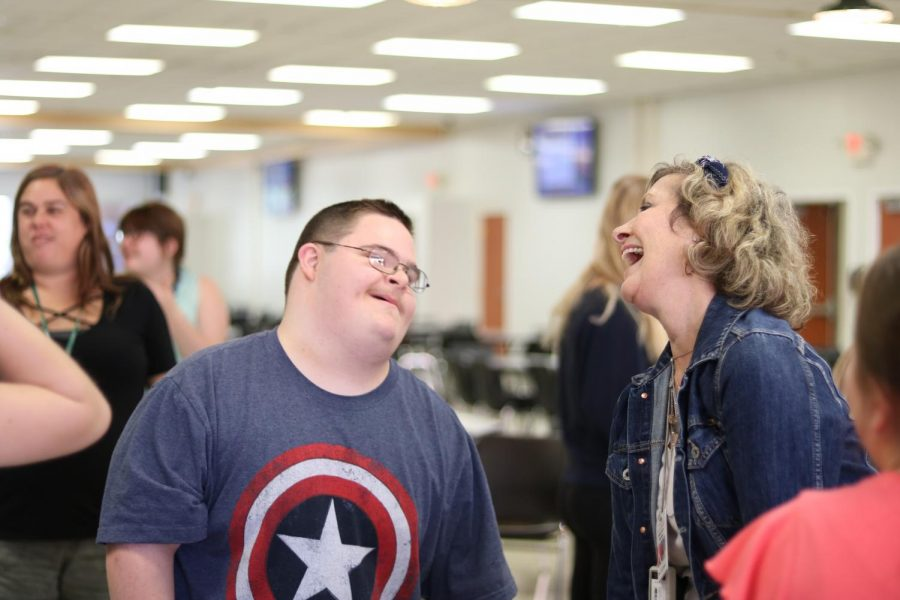 Graham Riggs and SSD substitute teacher Mrs. Dewes share a laugh at the Circle of Friends popsicle social.