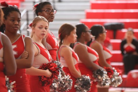 Cate Peters, sophomore, stands in line with the cheerleaders waiting for the team to be called out.