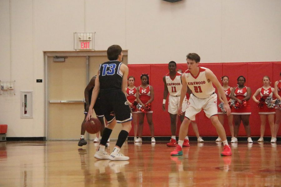 Jonah McDowell, senior, guards a Ladue player.