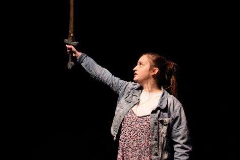 Olivia Button, sophomore, stands tall as she lifts her sword high to close out the production.