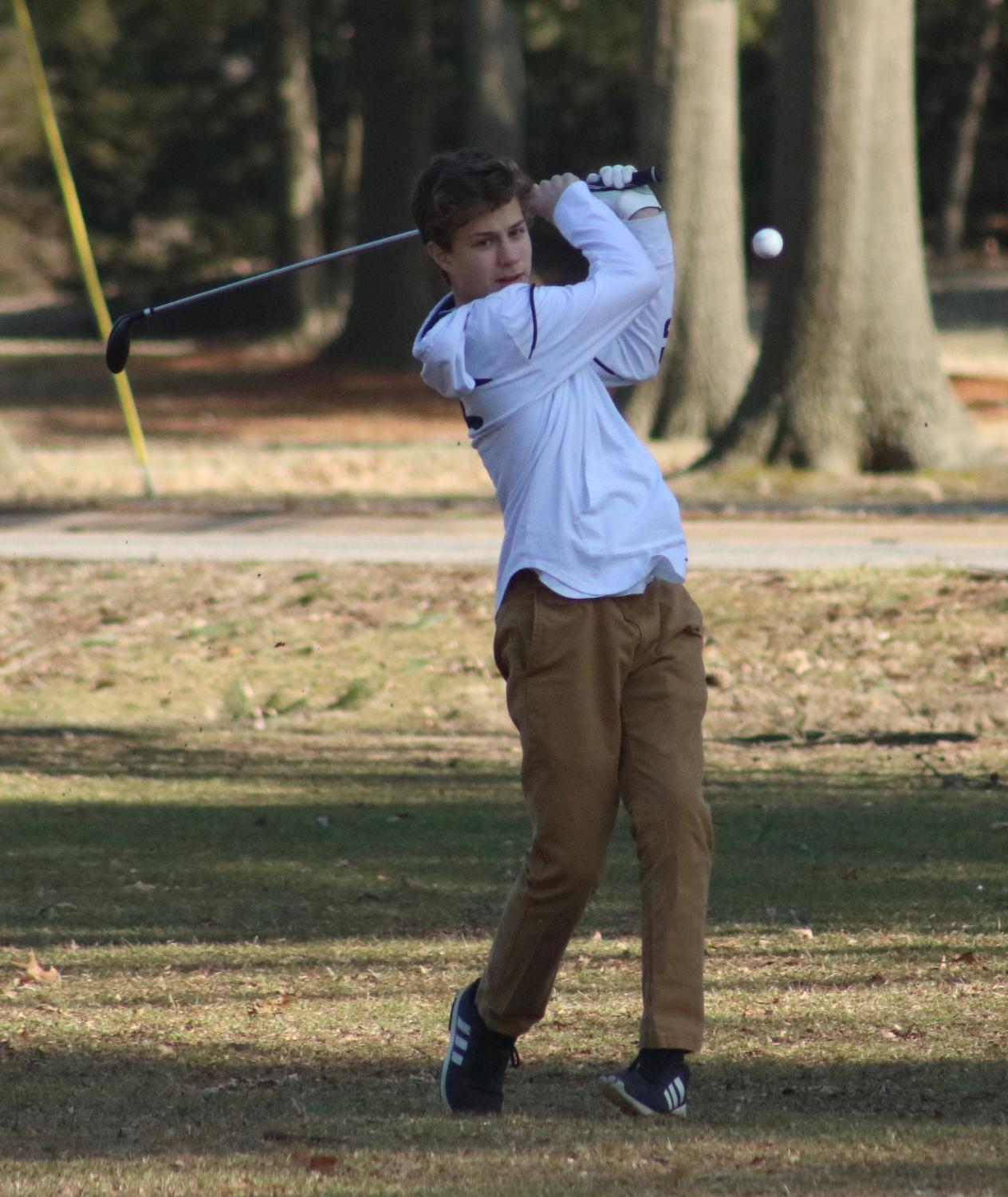 Wilson+Bruns%2C+freshman%2C+follows+his+ball+flight+during+his+tryout+round.