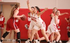 Eliana Poger, freshman, stands with her arms out to block a Parkway South player.