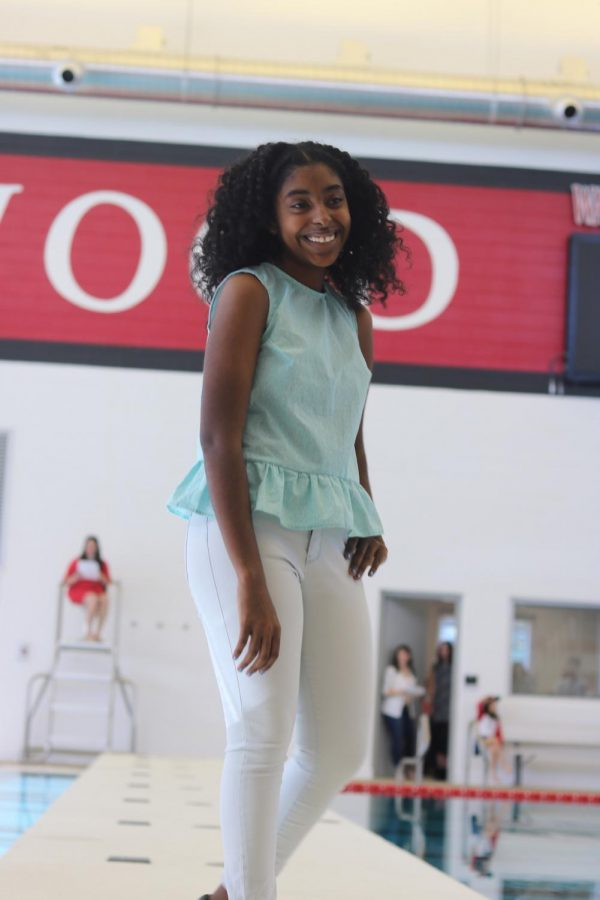 Mary+Alabsew%2C+sophomore%2C+smiles+as+she+poses+in+a+light+blue+tank+top+created+by+Ruby+Bailey.