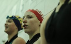 Aliya Swearngin, sophomore, stands before the crowd after placing 7th for the 50 freestyle with a time of 25:46.