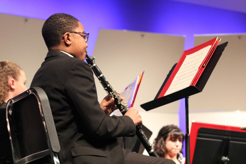 Brandon+Vahn%2C+freshman%2C+plays+his+clarinet+while+reading+his+sheet+music.