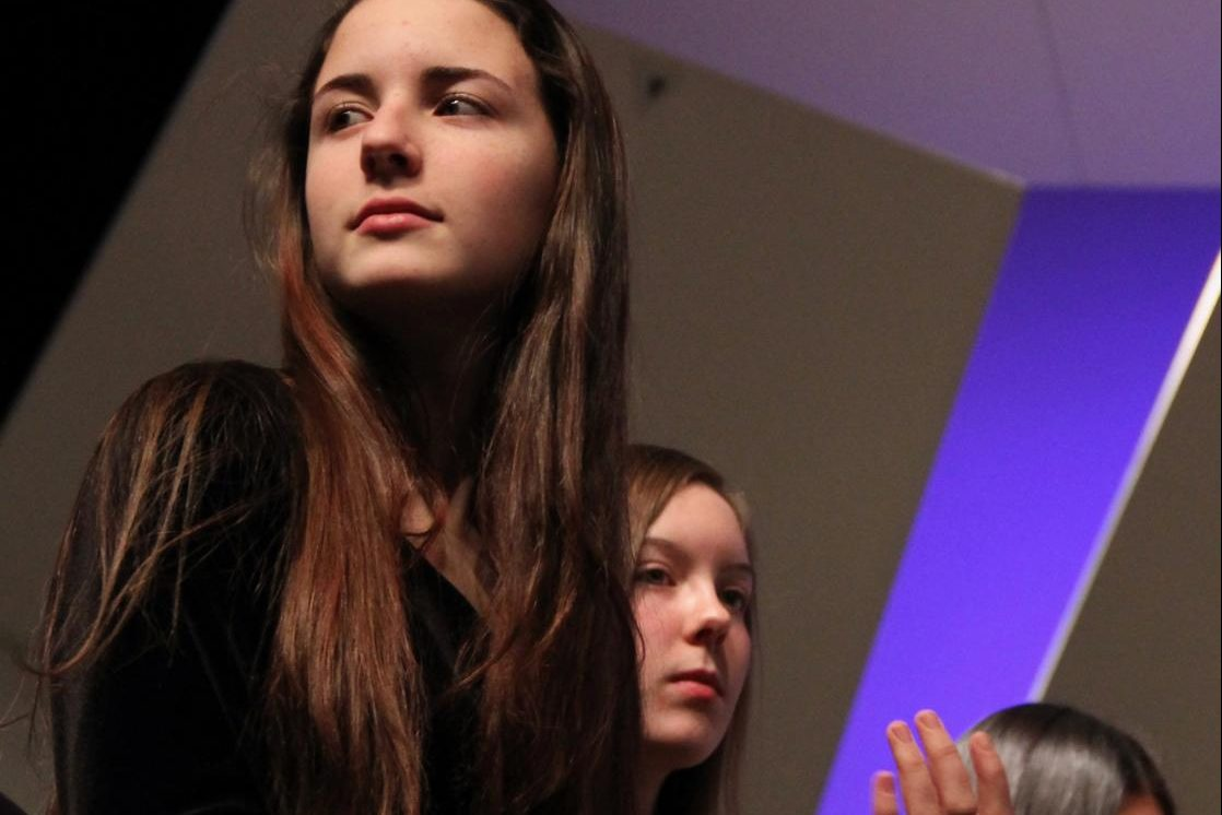 Phebe+Hammond%2C+sophomore%2C+looks+to+the+audience+whilst+applauding+after+a+performance.+%0A