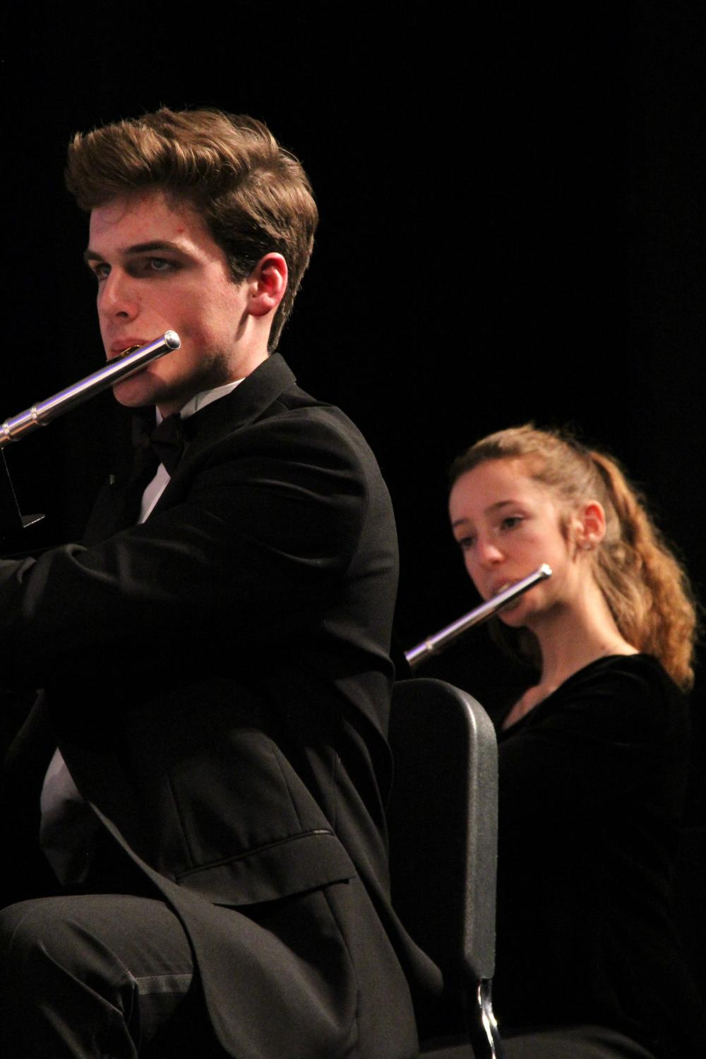 Will+Blackmore+and+Devin+Morgan%2C+sophomores%2C+play+their+flutes+during+a+woodwind+performance.+