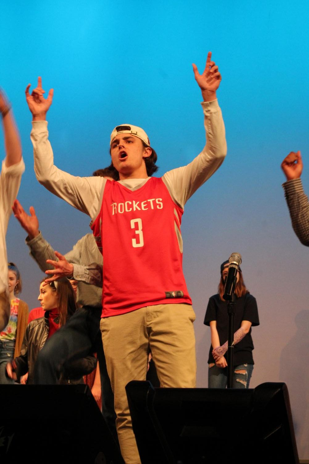 Garrett+Wright%2C+junior%2C+gets+into+the+song+during+the+Men%27s+and+Women%27s+Choral+performance.+