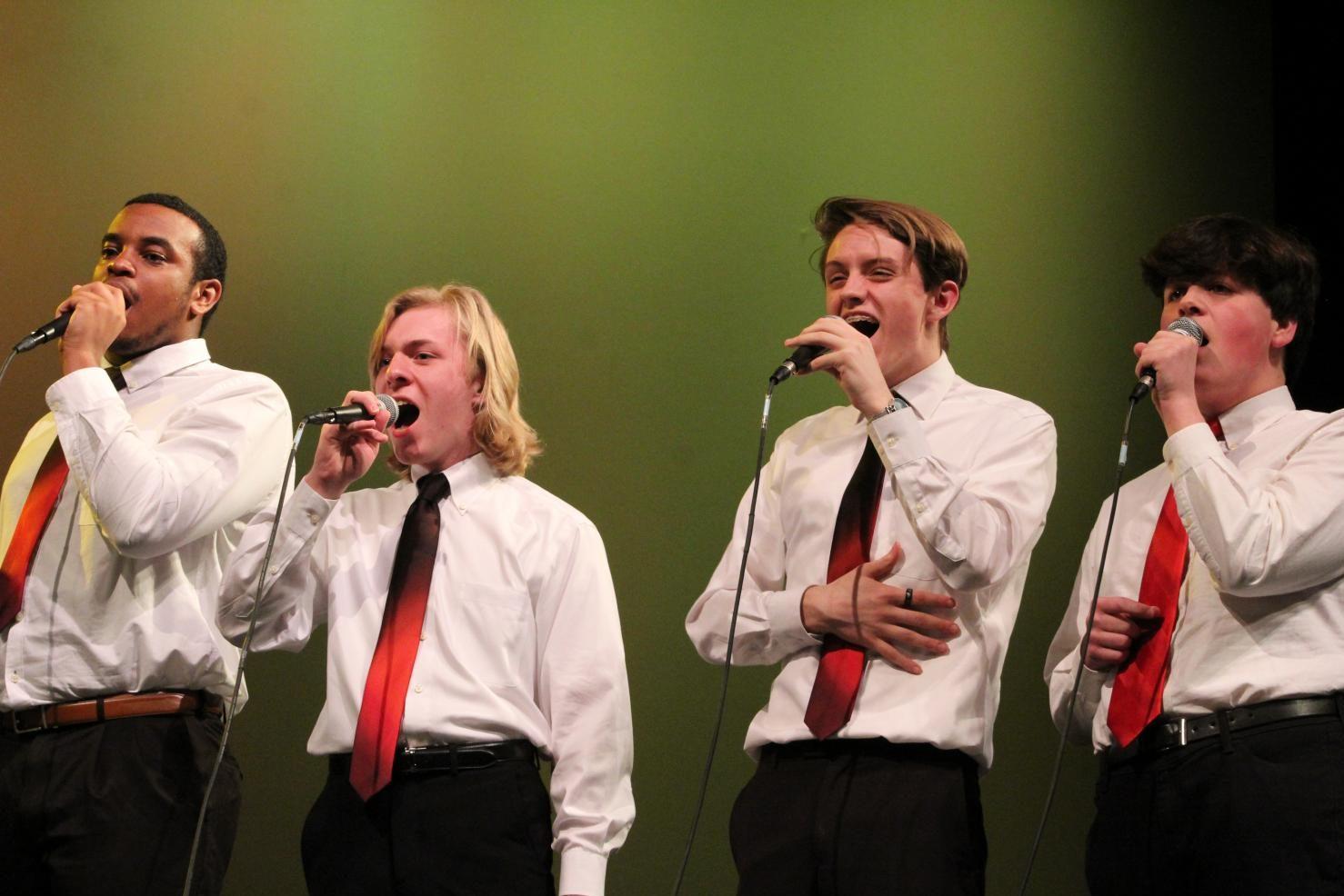 Anthony+Speech+and+Matt+Johnson%2C+seniors%2C+Xander+Piskulic%2C+sophomore+and+Mark+Perry%2C+junior%2C+sing+for+the+Kaleidoscope+Vocal+Jazz+Ensemble.+