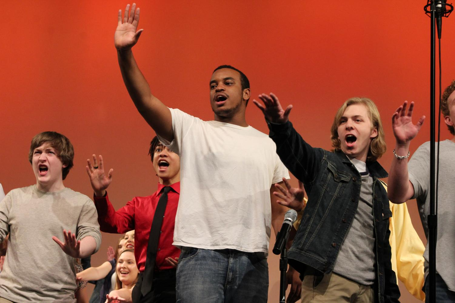 Anthony+Speech+and+Matt+Johnson%2C+seniors%2C+raise+their+arms+during+one+of+their+songs.
