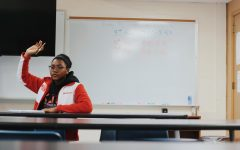 Samaya Trawick, Junior, raises her hand in math class to ask a question.
