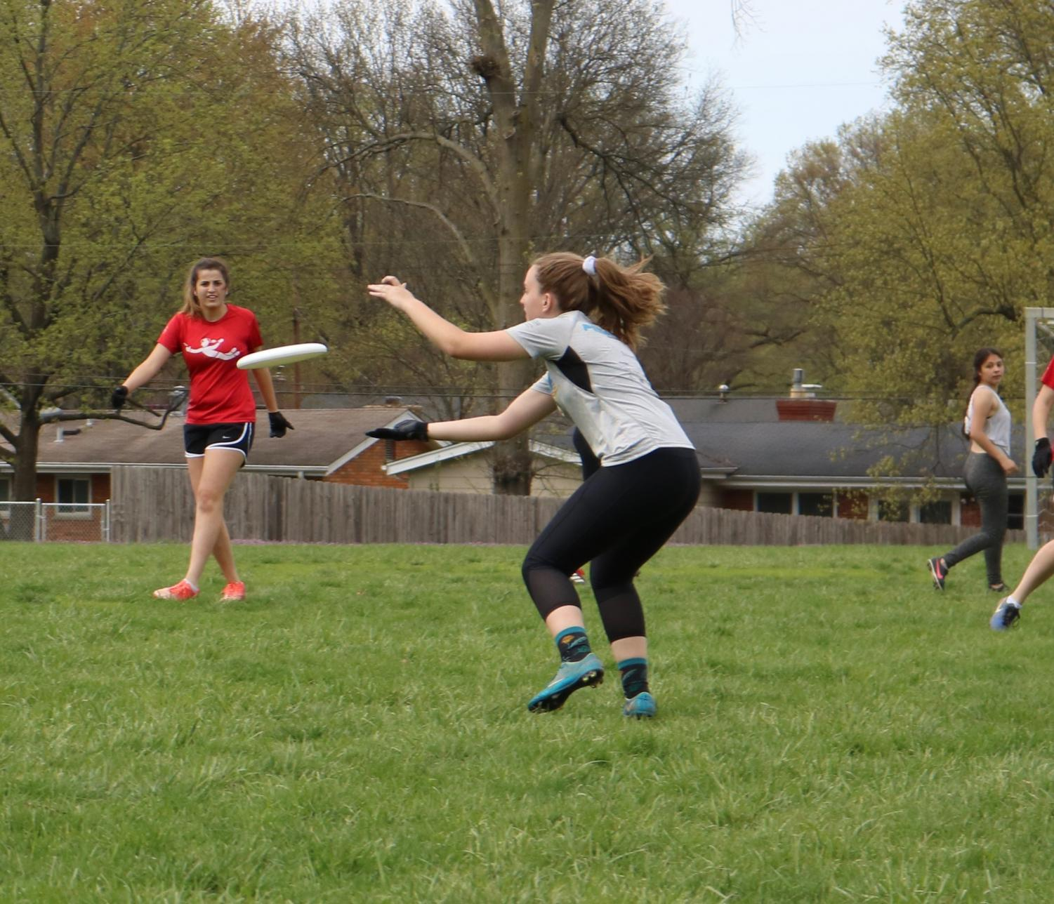 Eileen+Finley%2C+junior%2C+runs+to+catch+the+frisbee+during+a+scrimmage.+