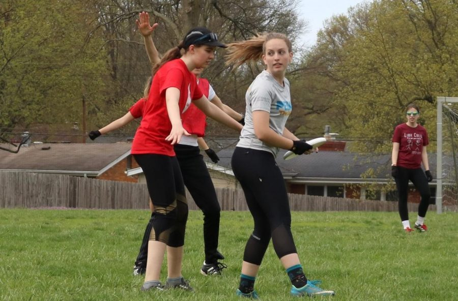 Eileen Finley, junior, pivots around Catherine Butler, sophomore, to find an opening to throw in.