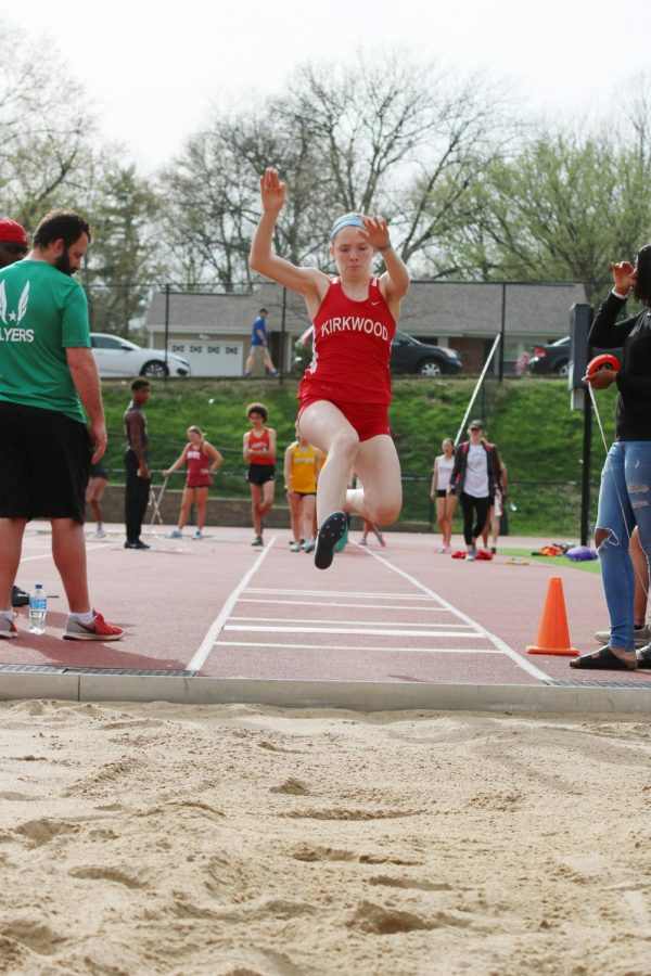 Kennedy+Mulvaney%2C+freshman%2C+looks+to+the+sand+as+she+competes+in+long+jump.+