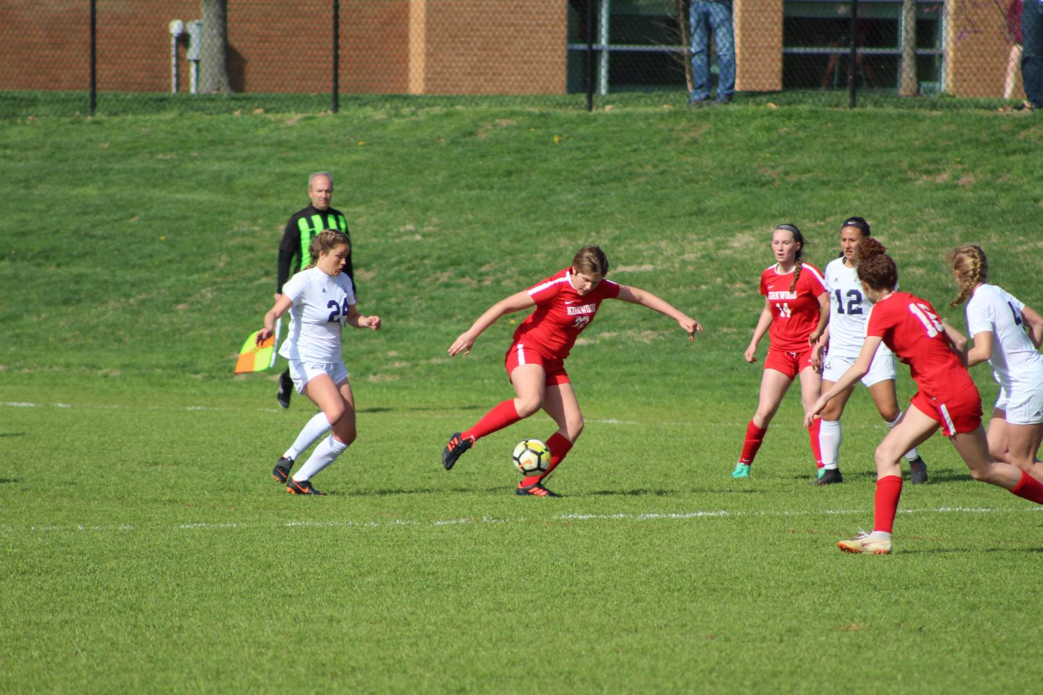 Evie Borbonus, sophomore,  makes sure the opposing team doesn't get the ball.