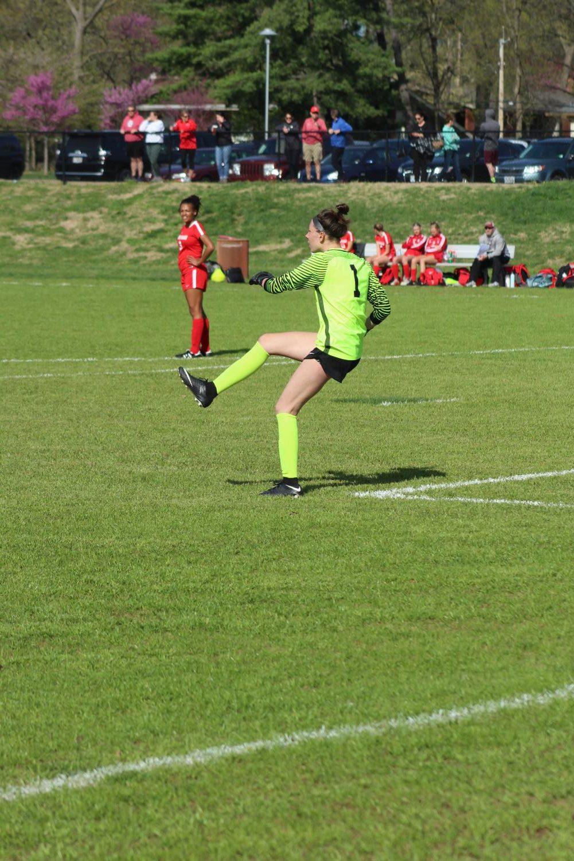 Natalie+Newman%2C+sophomore+and+goalie%2C+kicks+the+ball+