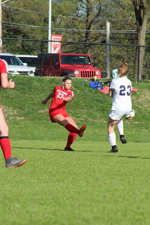 Molly+Sheridan%2C+senior%2C+kicks+the+ball+towards+the+goal+attempting+to+make+a+shot.+