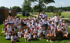 Campers and counselors gather outside for a group picture.