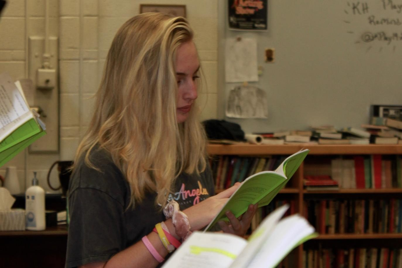 Jess Cohen, junior, studies her script during rehearsal for