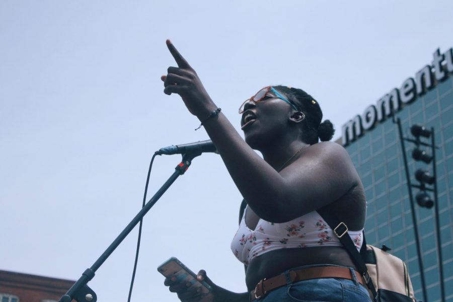 A protestor gives a passionate speech at the STLPSA march.
