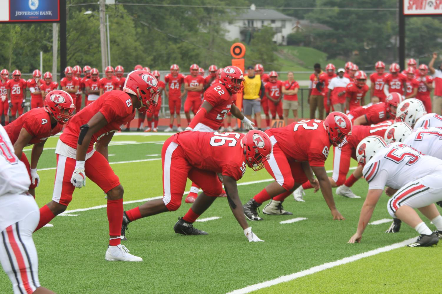 Will+Lee+%288%29%2C+Devrin+Williams+Jr.+%2856%29+and+Brendan+Arnold-Gill+%2862%29+get+ready+to+rush+the+passer.