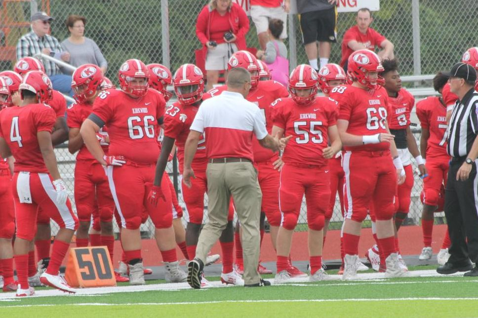 KHS+head+football+coach+Farrell+Shelton+shakes+hands+with+senior+Matthew+Connelly+%2855%29+before+the+game.