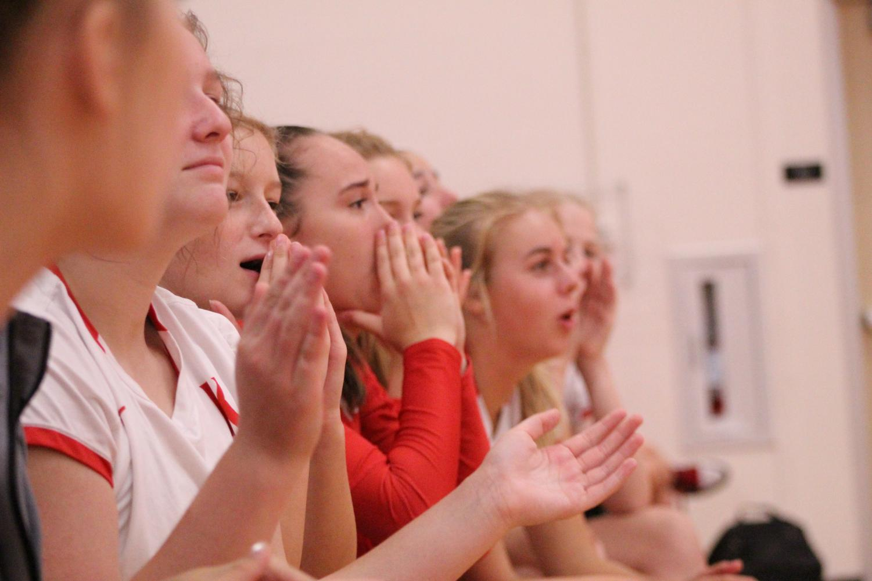 Sophia+Beckmann%2C+grade+10%2C+and+her+JV+team%2C+cheer+on+their+varsity+teammates.+