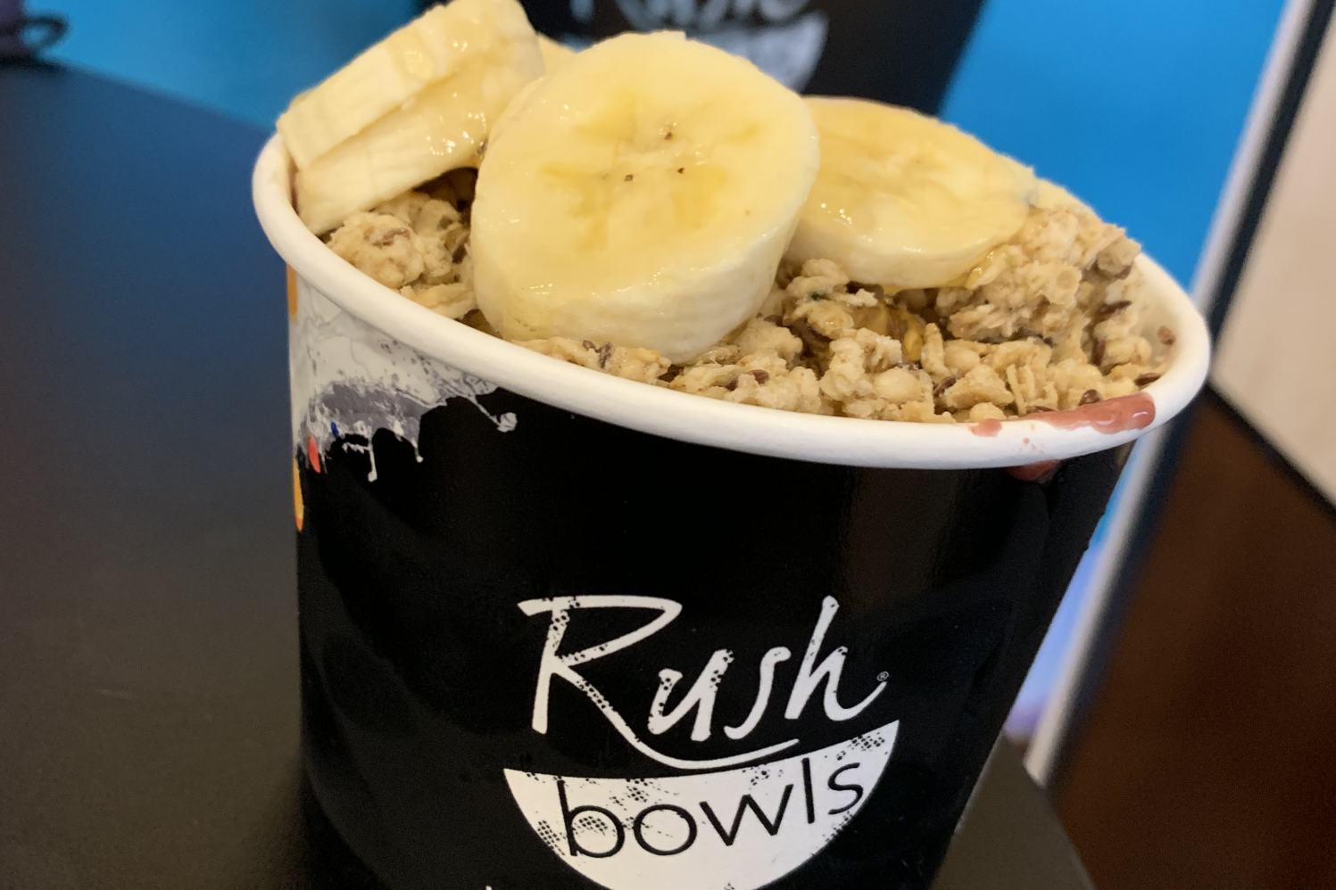 The 'Lemon Squeeze Acai' smoothie bowl, topped with granola, honey, and bananas.