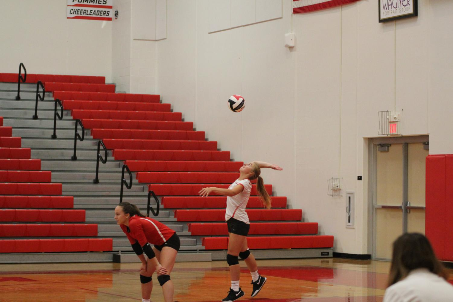 Olivia+Bolten%2C+grade+10%2C+serves+the+ball+in+the+JV+game.