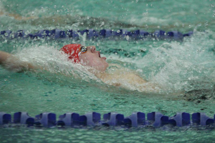 Andrew+Huebner%2C+freshman%2C+swims+backstroke.+