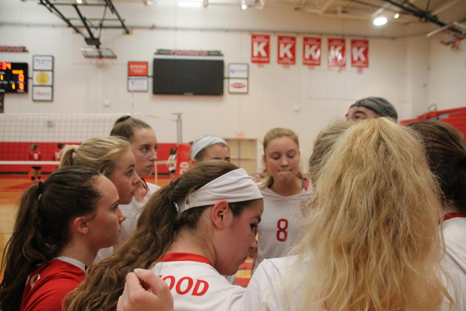 JV+volleyball+team+huddles+together+to+discuss+their+strategy.