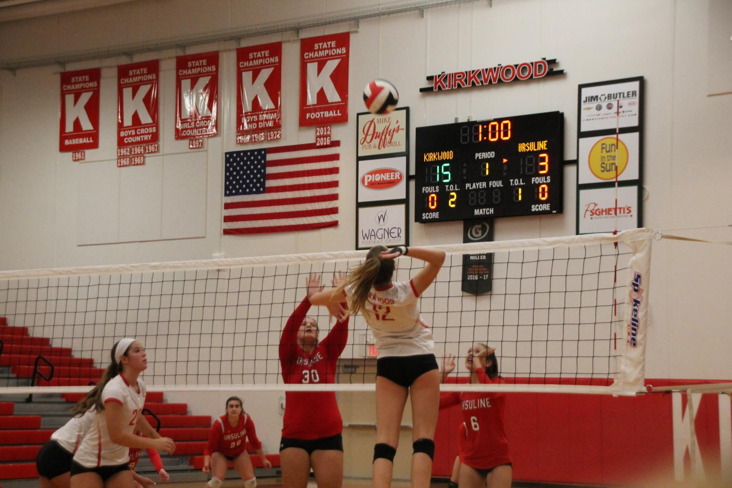 Audrey+Krus%2C+grade+10+spikes+ball+back+to+the+opposing+team.+